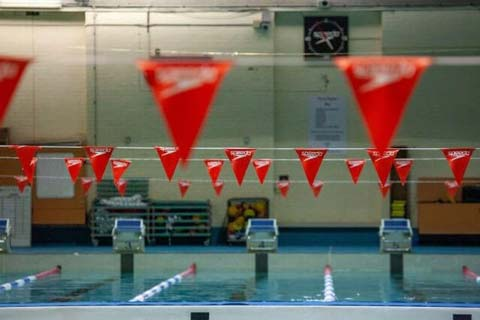 Image of the UNSW Fitness and Aquatic Centre pool with red bunting.